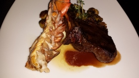 Veal chop and grilled lobster tail