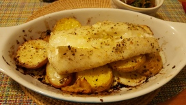Cod baked on potatoes